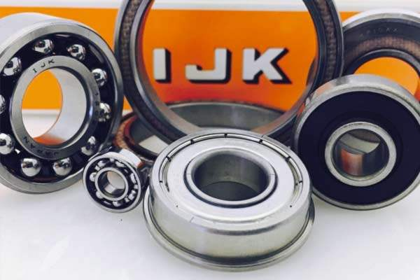 Image of an assortment of IJ Bearings products, including miniature ball bearings and angular ball bearings.